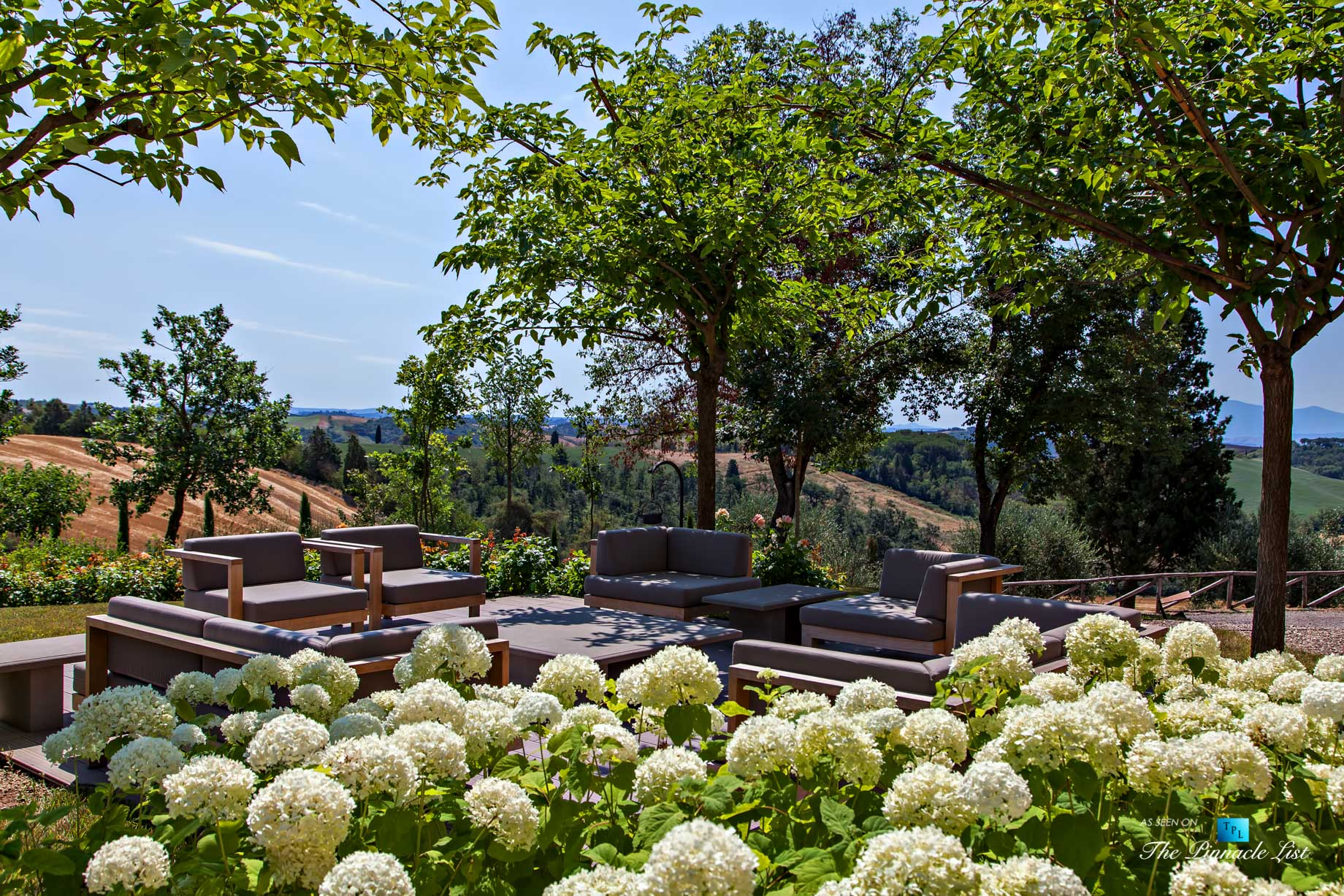 Podere Paníco Estate – Monteroni d'Arbia, Tuscany, Italy – Property Deck with Lounge Chairs – Luxury Real Estate – Tuscan Villa