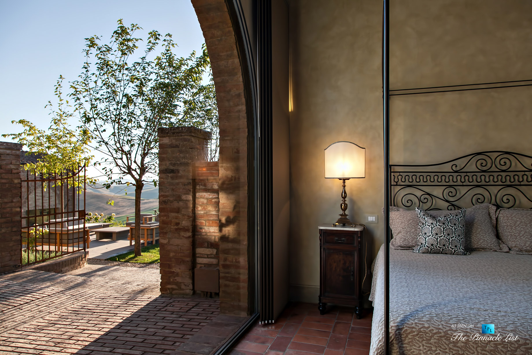 Podere Paníco Estate – Monteroni d'Arbia, Tuscany, Italy – Exterior Sitting Area and Bedroom View – Luxury Real Estate – Tuscan Villa