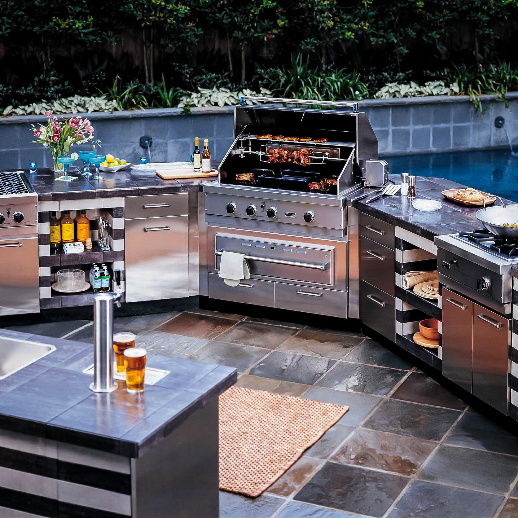 Luxury Outdoor Patio with Fully Equipped Exterior Kitchen Complete with Gas Grill