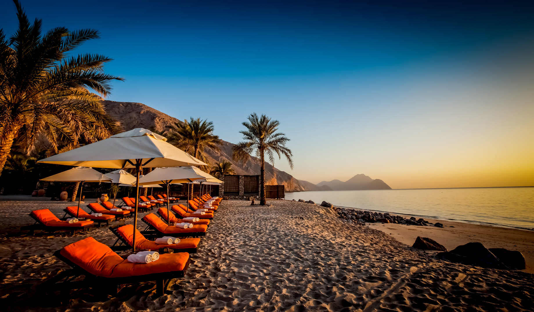 Oman Six Senses Luxury Resort Beach Chairs at Sunrise