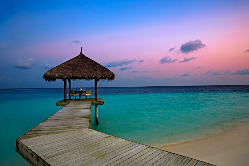 Velassaru Maldives Luxury Resort - South Male Atoll, Maldives - Beachfront Sunset