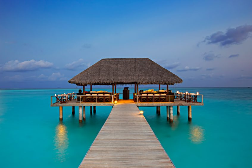 Velassaru Maldives Luxury Resort - South Male Atoll, Maldives - Overwater Restaurant Sunset