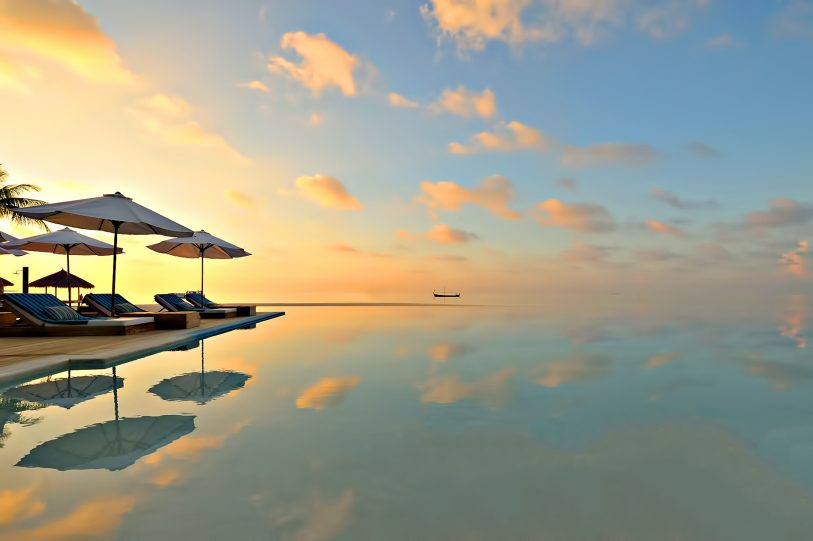 Velassaru Maldives Luxury Resort - South Male Atoll, Maldives - Infinity Pool Sunset