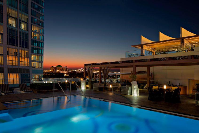 The St. Regis Abu Dhabi Luxury Hotel - Abu Dhabi, United Arab Emirates - Azura Panoramic Lounge Pool Night