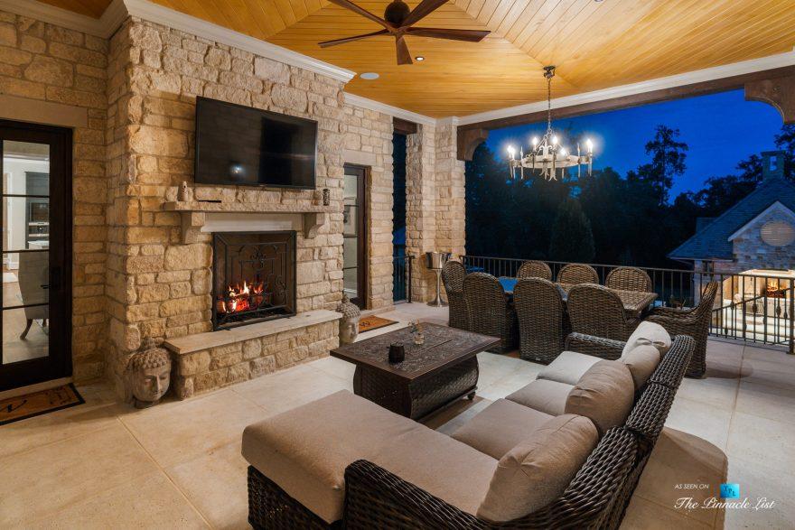 1150 W Garmon Rd, Atlanta, GA, USA - Covered Deck with Fireplace at Night - Luxury Real Estate - Buckhead Estate House