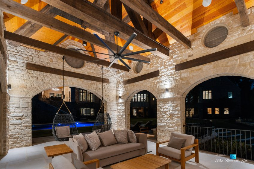 1150 W Garmon Rd, Atlanta, GA, USA - Covered Deck with Suspended Chairs at Night - Luxury Real Estate - Buckhead Estate House