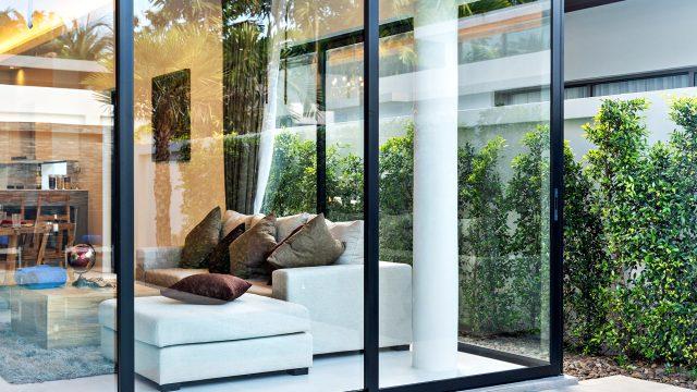 Open Plan Living Area with Glass Sliding Door and Garden