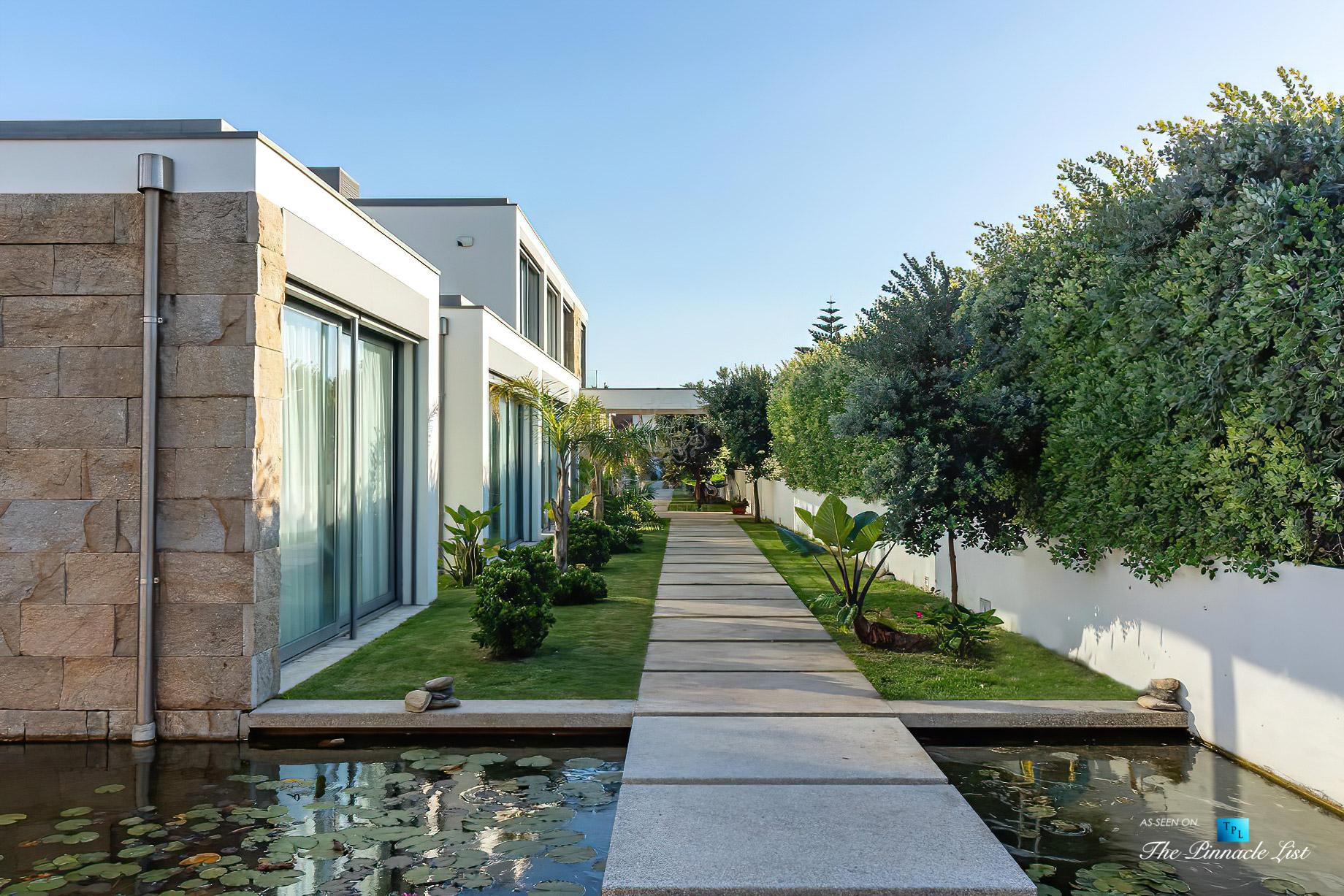 Francelos Beach Luxury T5 Villa – Porto, Portugal – Exterior Pond Walkway – Luxury Real Estate – Modern Home
