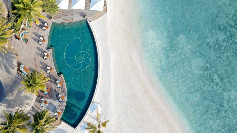 The Nautilus Maldives Luxury Resort - Thiladhoo Island, Maldives - Resort Beachfront Pool Aerial