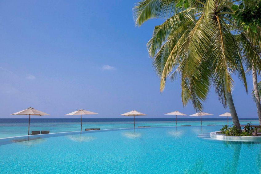 Amilla Fushi Luxury Resort and Residences - Baa Atoll, Maldives - Oceanfront Pool Beach Chairs and Umbrellas
