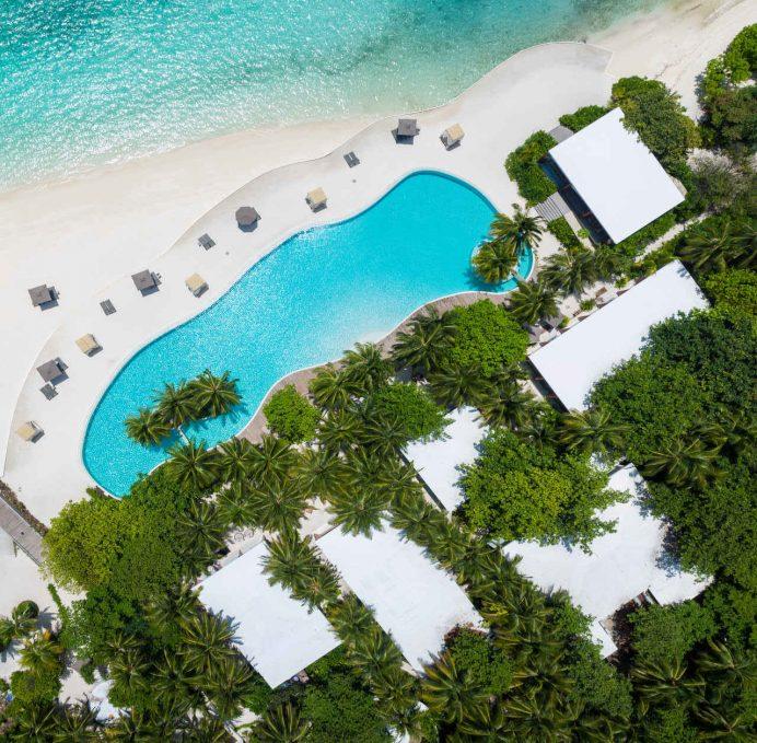 Amilla Fushi Luxury Resort and Residences - Baa Atoll, Maldives - Oceanfront Infinity Edge Pool Overhead Aerial