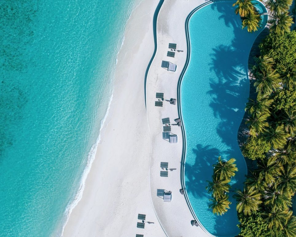 Amilla Fushi Luxury Resort and Residences - Baa Atoll, Maldives - Oceanfront Infinity Edge Pool Overhead Aerial View