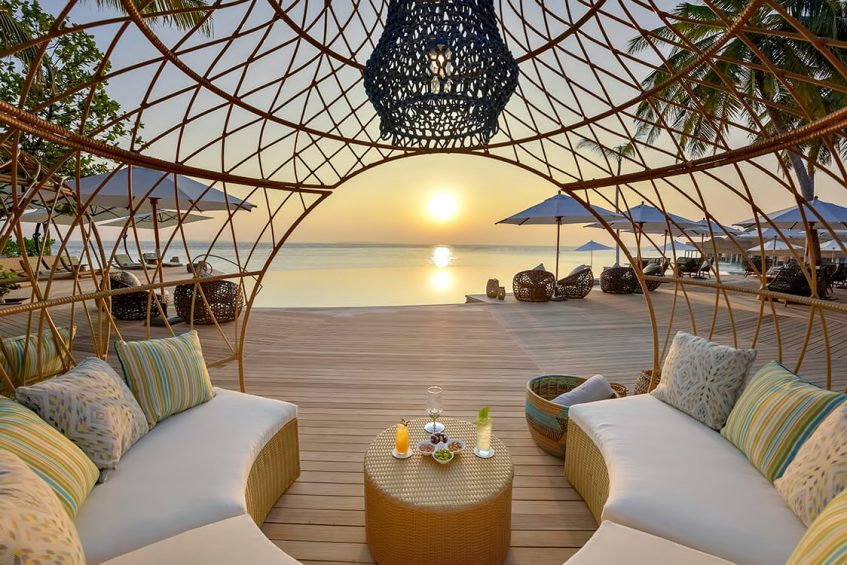 The Nautilus Maldives Luxury Resort - Thiladhoo Island, Maldives - Beachfront Poolside Lounge Sunset