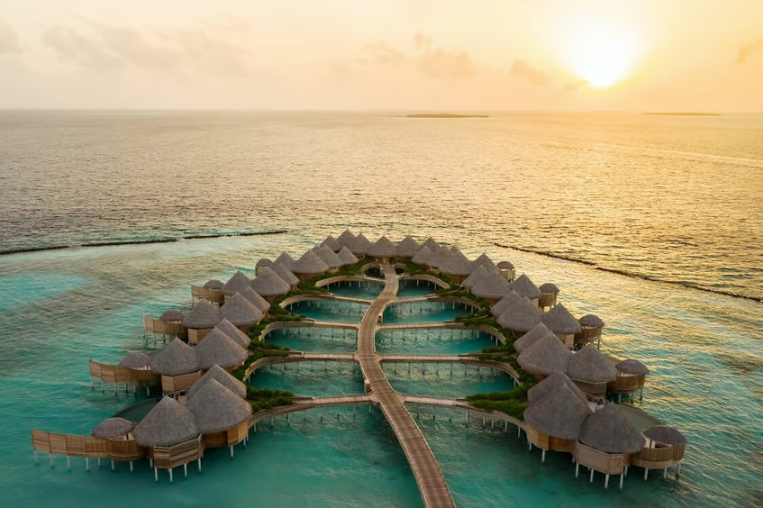 The Nautilus Maldives Luxury Resort - Thiladhoo Island, Maldives - Resort Aerial Sunset View