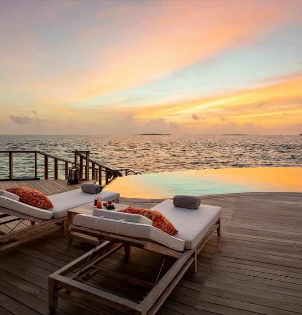 The Nautilus Maldives Luxury Resort - Thiladhoo Island, Maldives - Overwater Residence Lounge Chairs Sunset