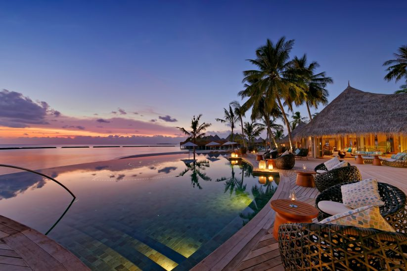 The Nautilus Maldives Luxury Resort - Thiladhoo Island, Maldives - Resort Infinity Pool Sunset
