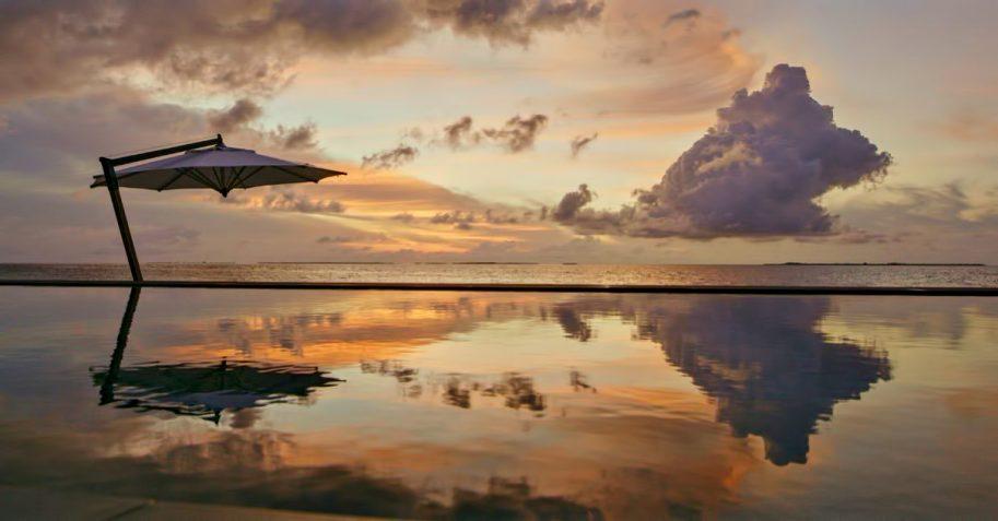 Cheval Blanc Randheli Luxury Resort - Noonu Atoll, Maldives - Beachfront Infinity Pool Sunset