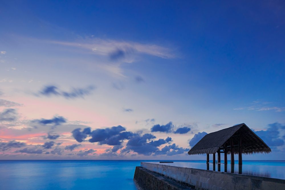 One&Only Reethi Rah Luxury Resort - North Male Atoll, Maldives - Overwater Lap Pool Sunset
