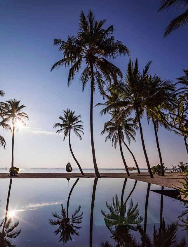 One&Only Reethi Rah Luxury Resort - North Male Atoll, Maldives - Palm Tree Chair Beach Pool View Twilight