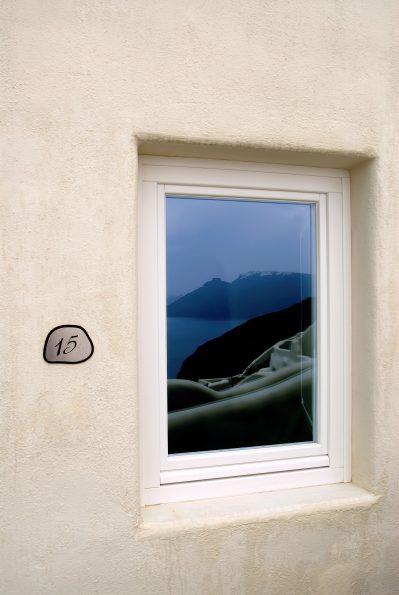 Mystique Luxury Hotel Santorini – Oia, Santorini Island, Greece - Room Exterior Window Ocean View Reflection