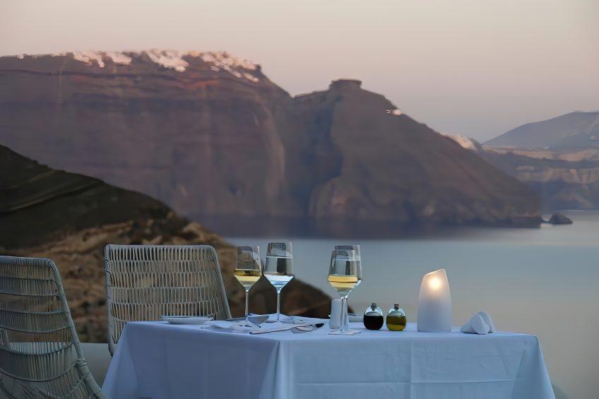 Mystique Luxury Hotel Santorini – Oia, Santorini Island, Greece - Cliffside Restaurant Table Sea View