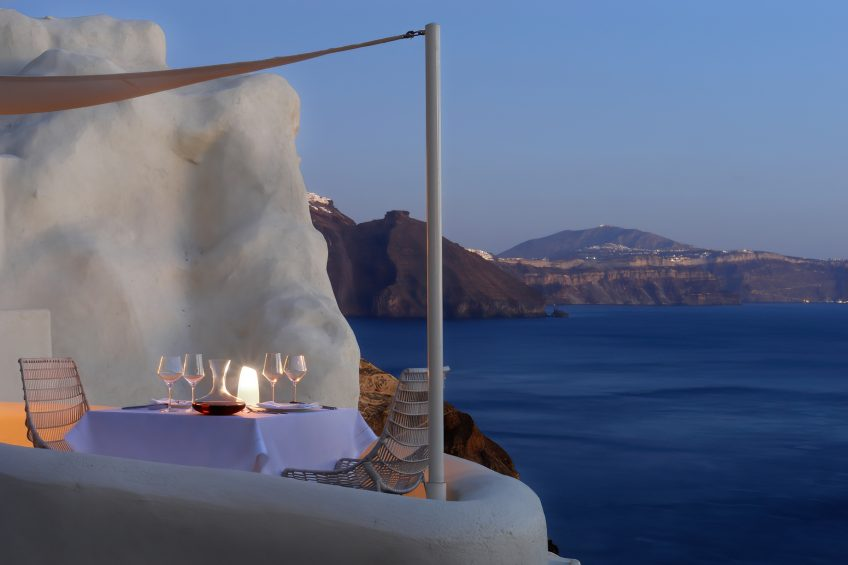 Mystique Luxury Hotel Santorini – Oia, Santorini Island, Greece - Cliffside Dining Table Ocean View