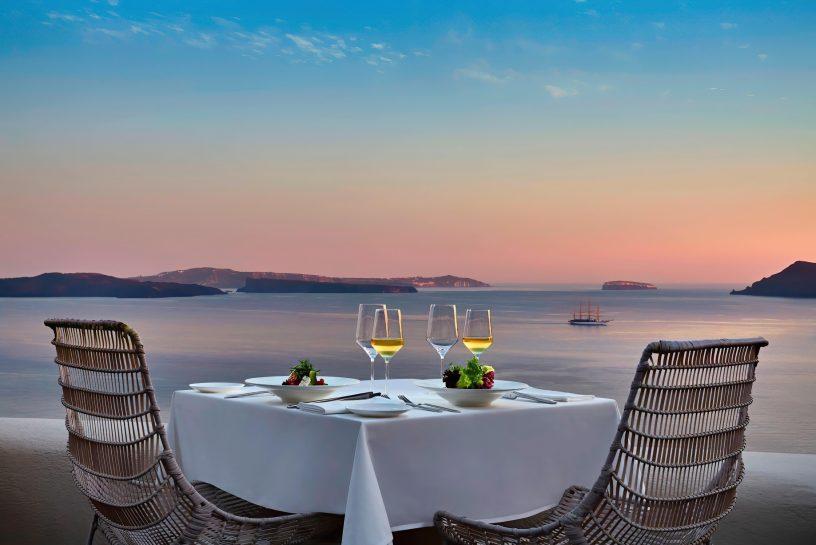 Mystique Luxury Hotel Santorini – Oia, Santorini Island, Greece - Cliffside Dining Table Sea View