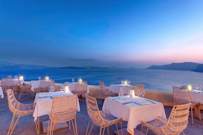 Mystique Luxury Hotel Santorini – Oia, Santorini Island, Greece - Cliffside Dining Tables Sea View