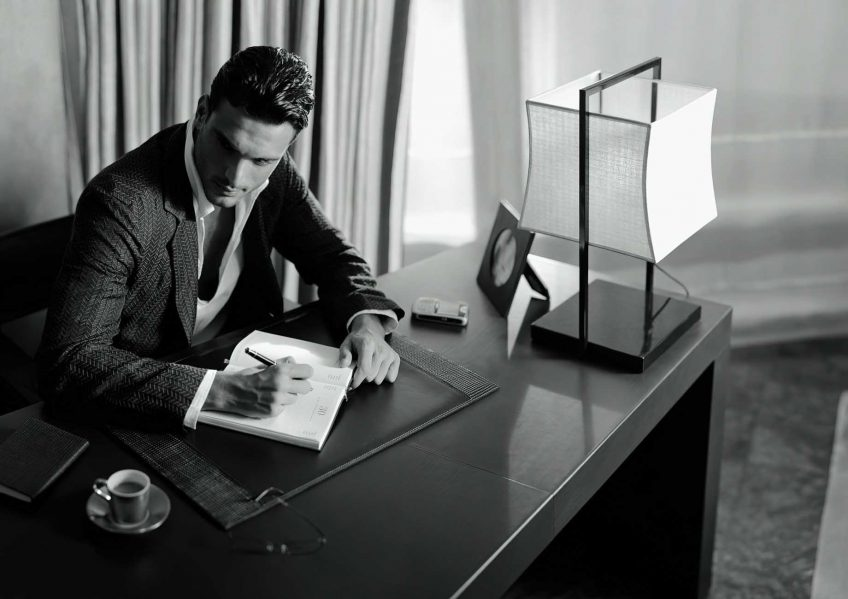 Armani Luxury Hotel Milano - Milan, Italy - Hotel Guest Sitting at Desk