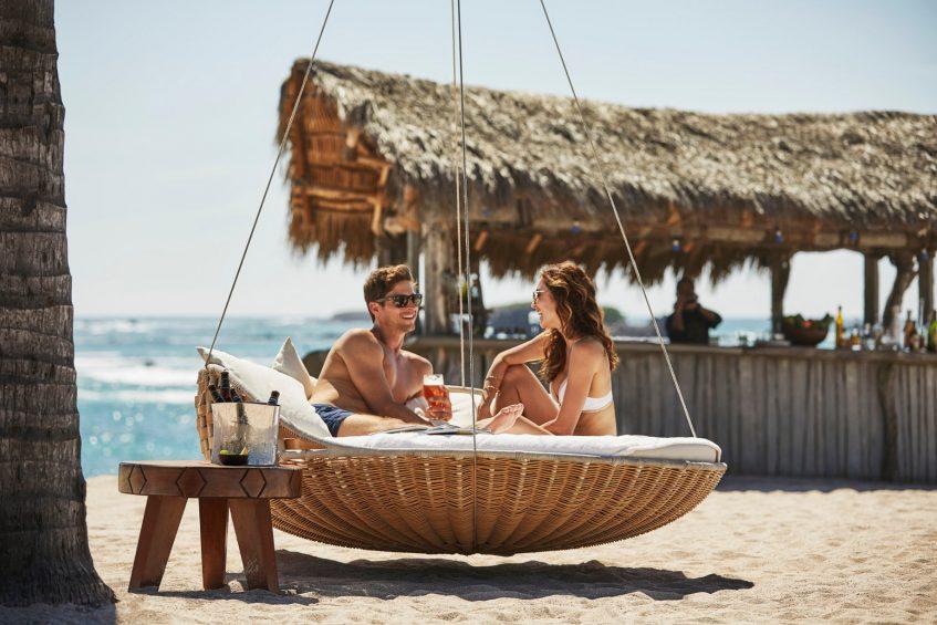 Four Seasons Luxury Resort Punta Mita - Nayarit, Mexico - Couple at Beach Bar