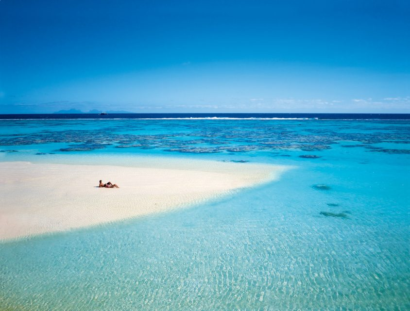 The Brando Luxury Resort - Tetiaroa Private Island, French Polynesia - Couple Lying on Beach