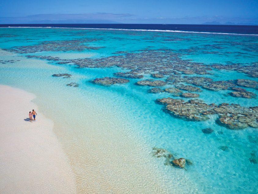 The Brando Luxury Resort - Tetiaroa Private Island, French Polynesia - Couple Walking on Beach