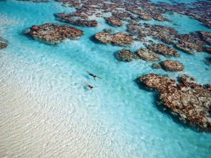 The Brando Luxury Resort - Tetiaroa Private Island, French Polynesia - Couple Swimming in Ocean