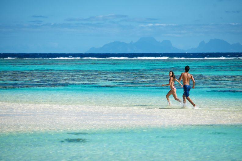 The Brando Luxury Resort - Tetiaroa Private Island, French Polynesia - Couple Running on Beach