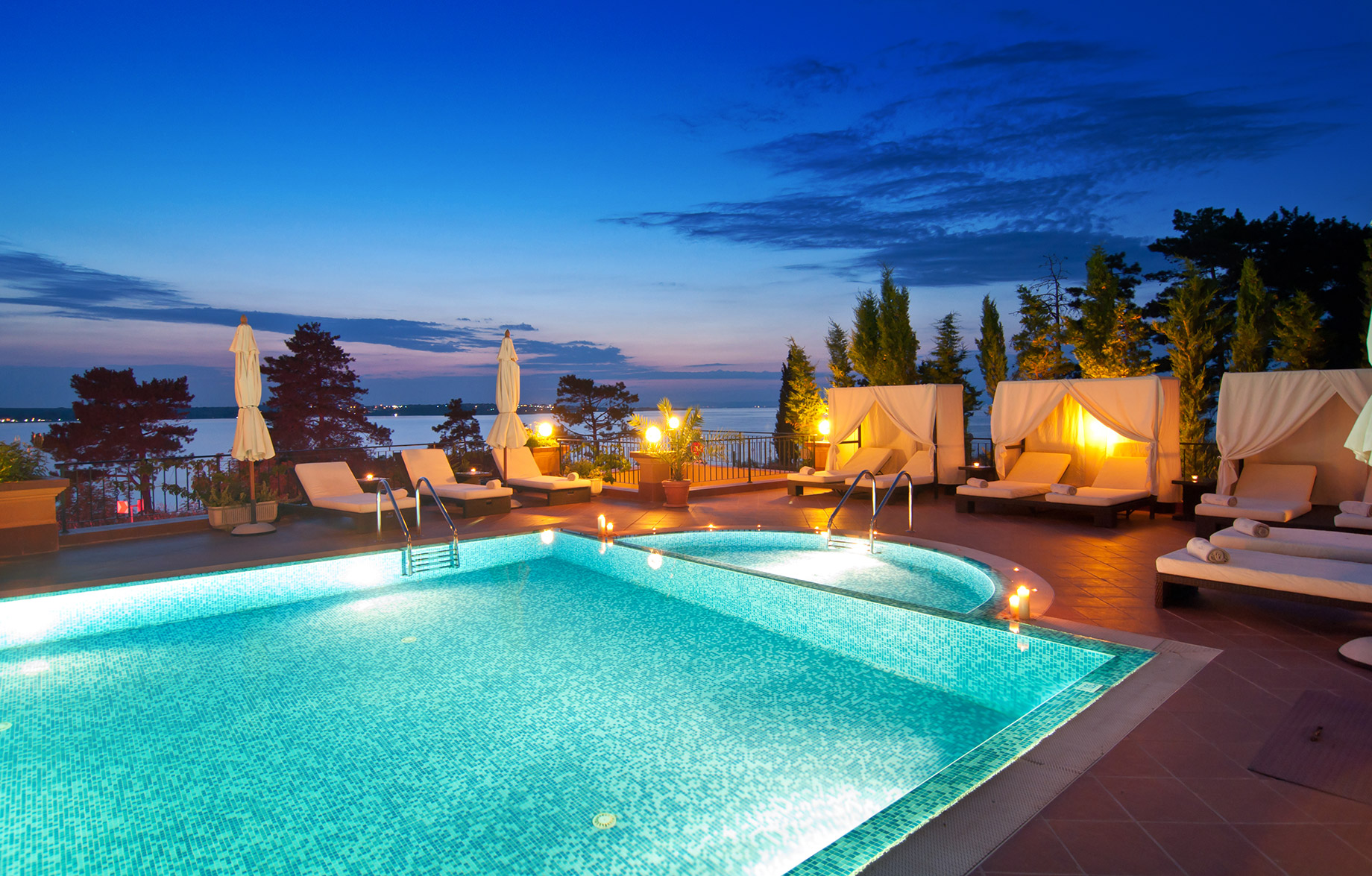 Luxury Travel – Poolside at Night with Sea Views