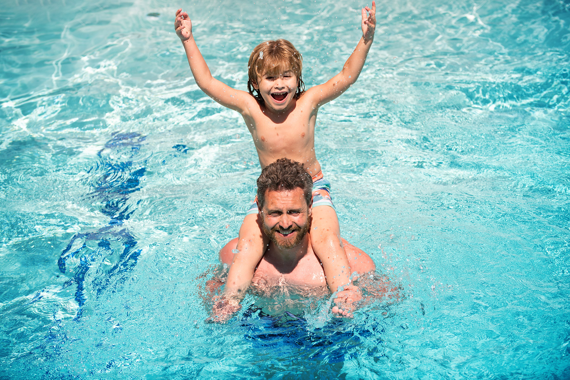 Summer Fun with a Father and Son in a Swimming Pool