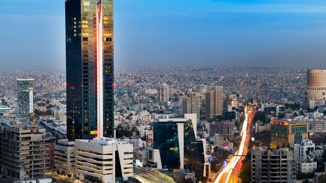 W Amman Luxury Hotel - Amman, Jordan - Hotel Tower Exterior Sunset