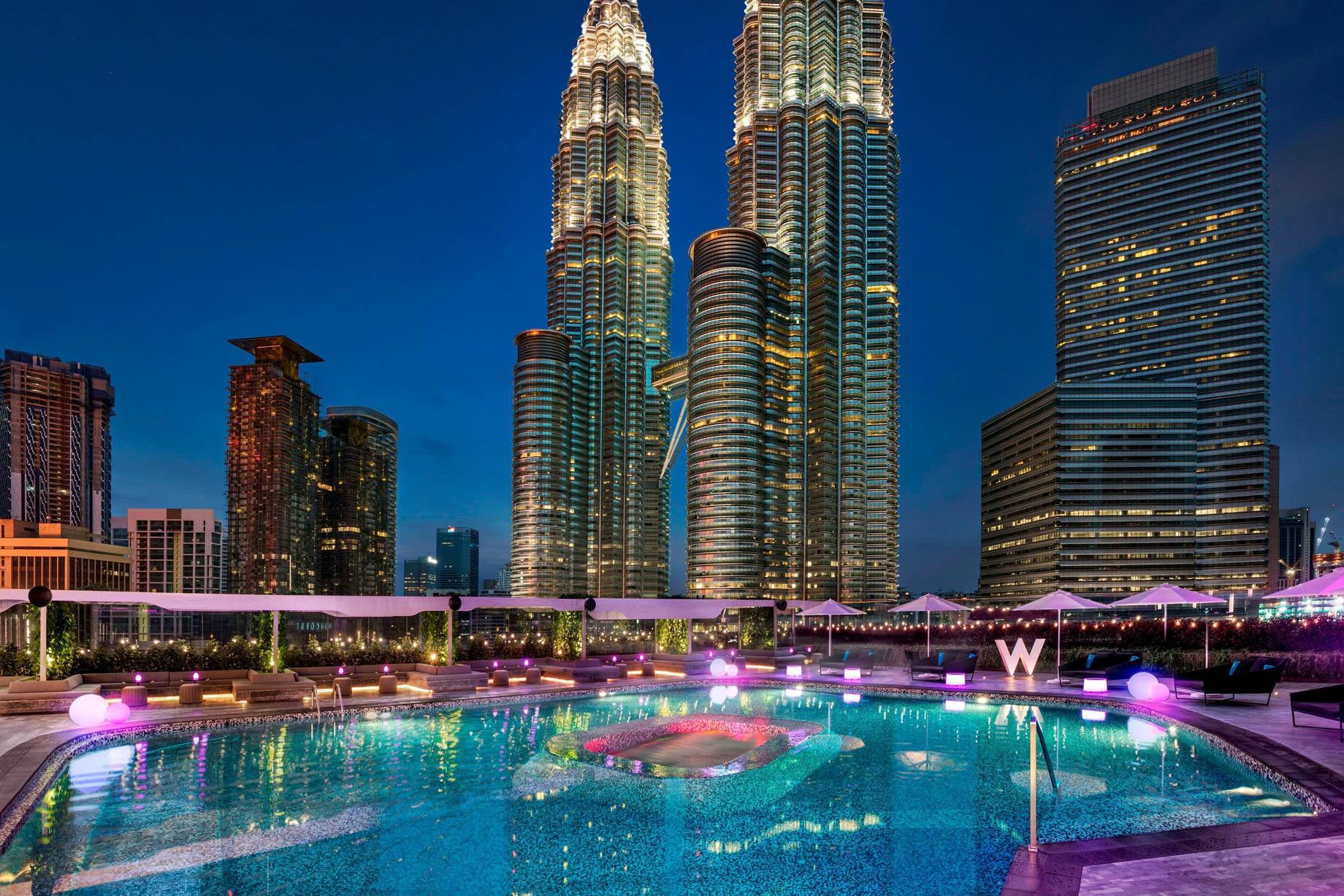 W Kuala Lumpur Luxury Hotel - Kuala Lumpur, Malaysia - WET Outdoor Pool Petronis Towers Night View