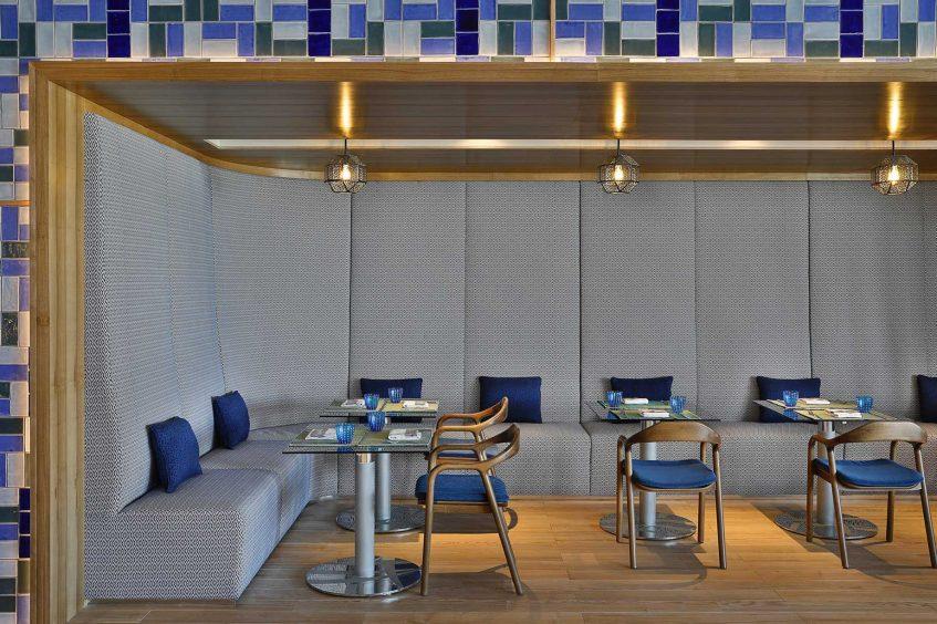 W Muscat Luxury Resort - Muscat, Oman - Harvest Restaurant Booth Tables