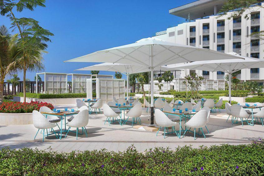 W Muscat Luxury Resort - Muscat, Oman - Harvest Outdoor Tables with Umbrellas