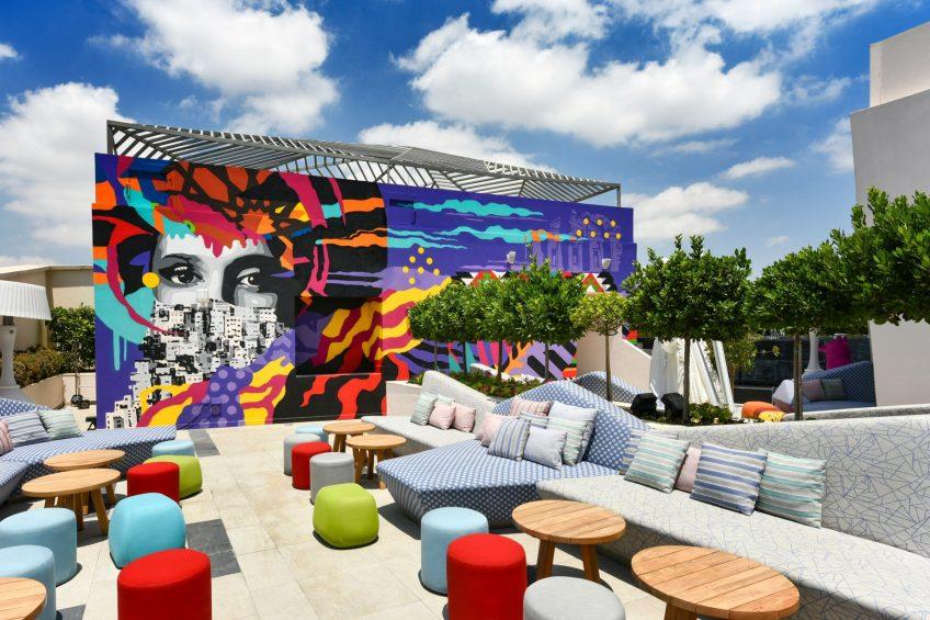W Amman Luxury Hotel - Amman, Jordan - Dina Saadi Mural Outdoor Lounge