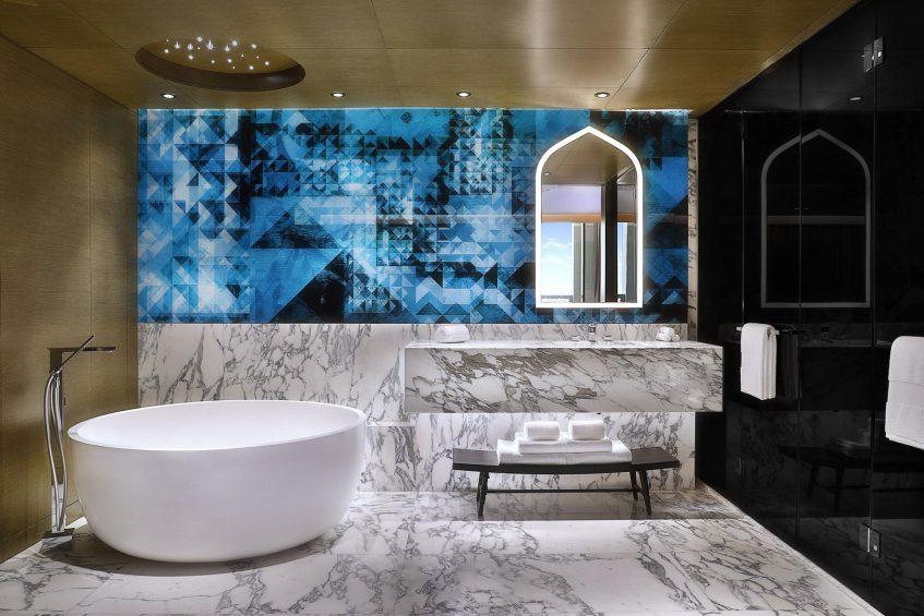 W Muscat Luxury Resort - Muscat, Oman - Suite Blue Bathroom and Tub
