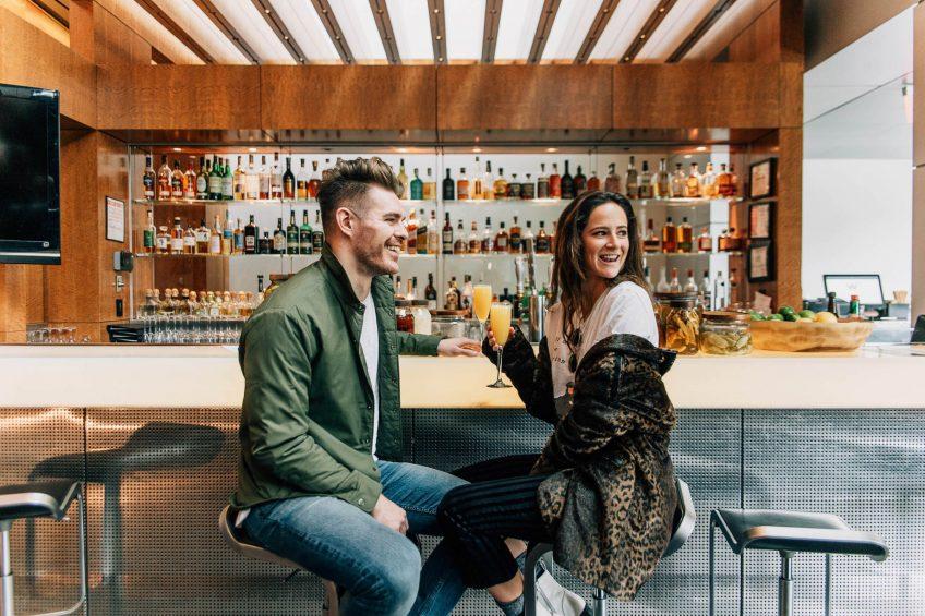 W Hoboken Luxury Hotel - Hoboken, NJ, USA - Living Room Bar Couple