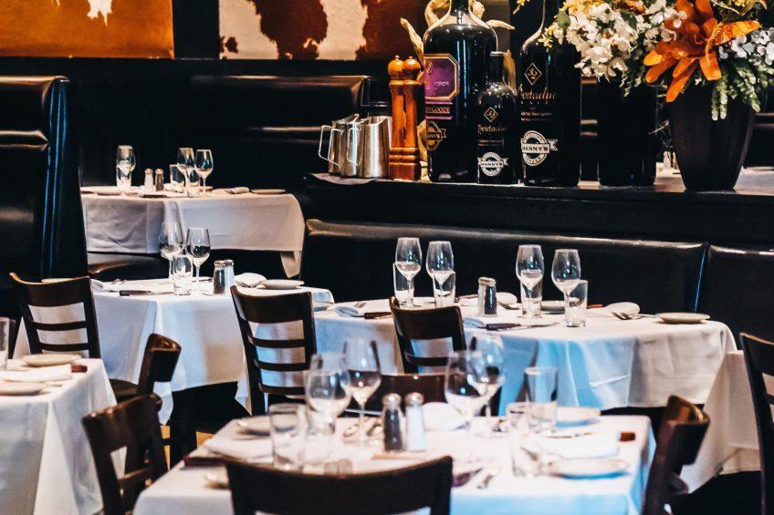 W Minneapolis The Foshay Luxury Hotel - Minneapolis, MN, USA - Manny's Steakhouse Tables