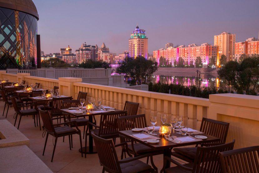 The St. Regis Astana Luxury Hotel - Astana, Kazakhstan - Exterior Terrace Tables Night