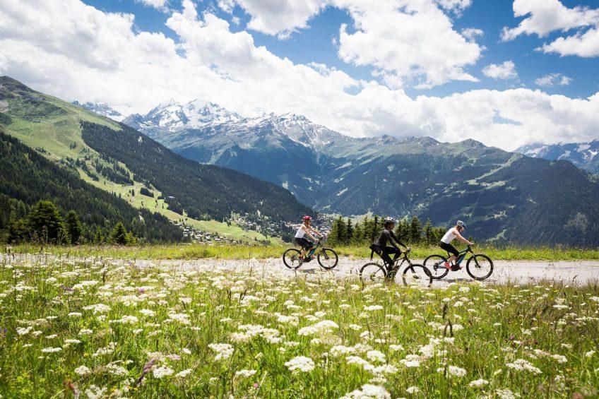 W Verbier Luxury Hotel - Verbier, Switzerland - Biking on Mountain