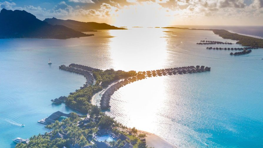 The St. Regis Bora Bora Resort - Bora Bora, French Polynesia - Resort Aerial Sunset